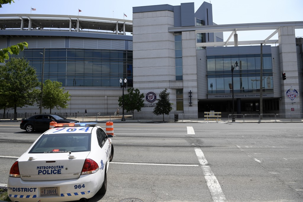A police car is seen across from Nationals Park, Sunday, July 18, 2021, in Washington. A baseball game between the San Diego Padres and Washington was...