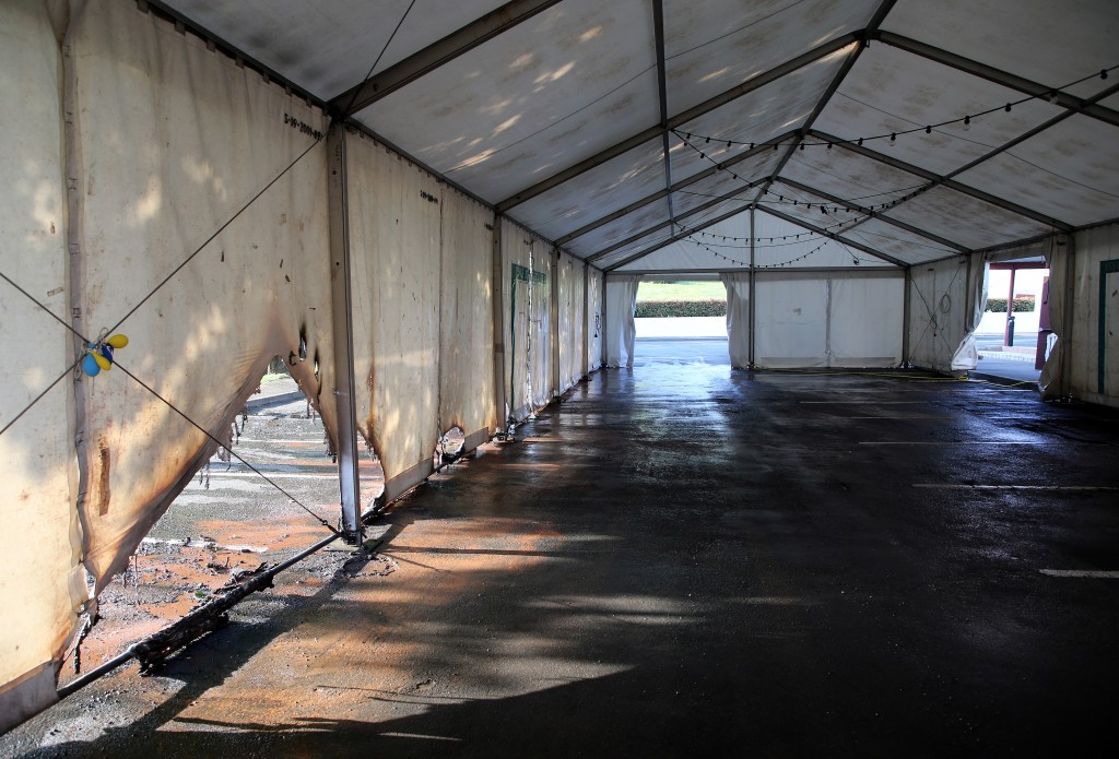 A view of the empty tent of a vaccination center after an arson attack on Saturday evening in Urrugne, southwestern France, Monday, July 19, 2021.Two ...