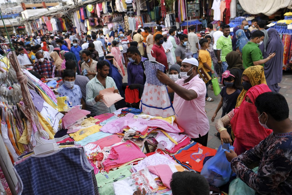 People shop at a market ahead of Eid-al Adha in Dhaka, Bangladesh, Friday, July 16, 2021. Millions of Bangladeshis are shopping and traveling during a...