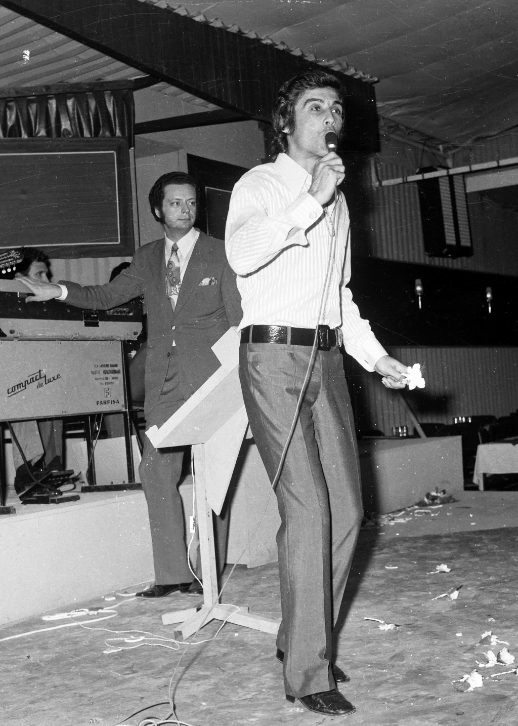 In this June 13, 1971, file photo, Greek popular folk singer Tolis Voskopoulos performs at a music hall in Athens, Greece. Considered a legend of mode...