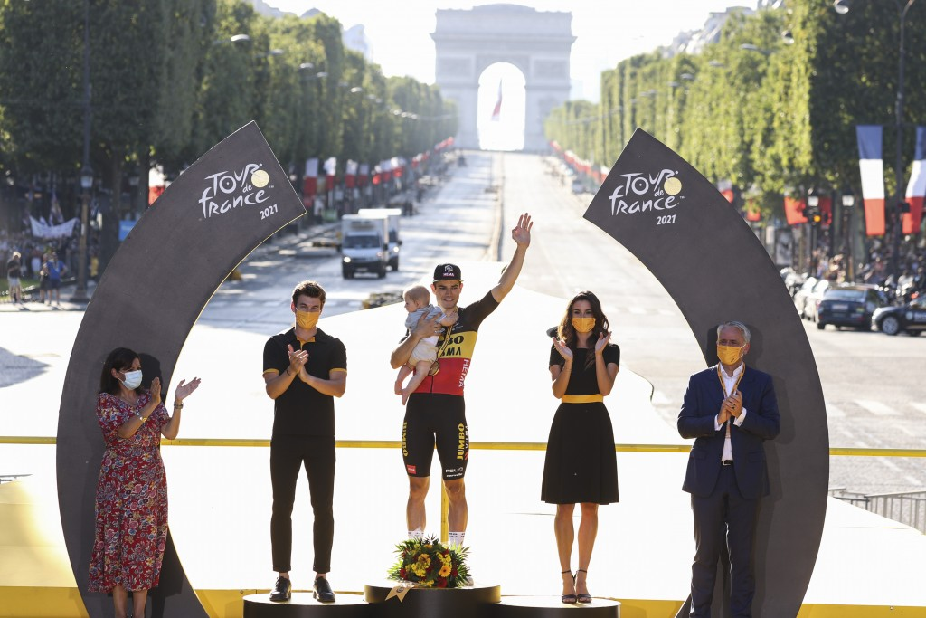 Stage winner Belgium's Wout Van Aert celebrates on the podium after the twenty-first and last stage of the Tour de France cycling race over 108.4 kilo...