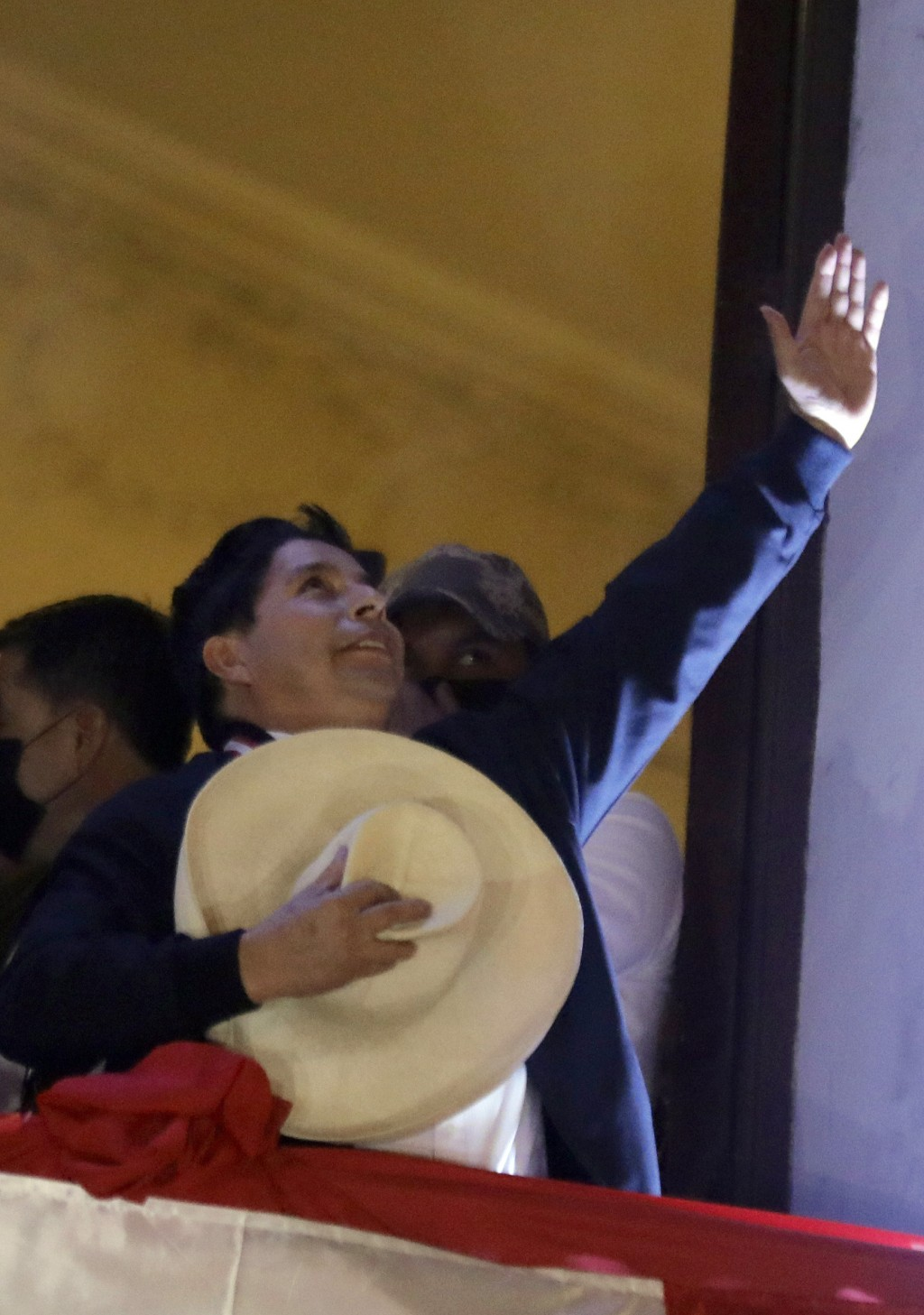 Pedro Castillo celebrates after being declared president-elect by election authorities, at his campaign headquarters in Lima, Peru, Monday, July 19, 2...