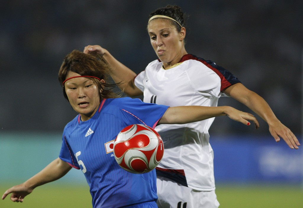 FILE - In this Aug. 18, 2008, file photo, Carli Loyd, right, of the U.S., vies for the ball with Mizuho Sakaguchi, of Japan, during the Beijing 2008 O...
