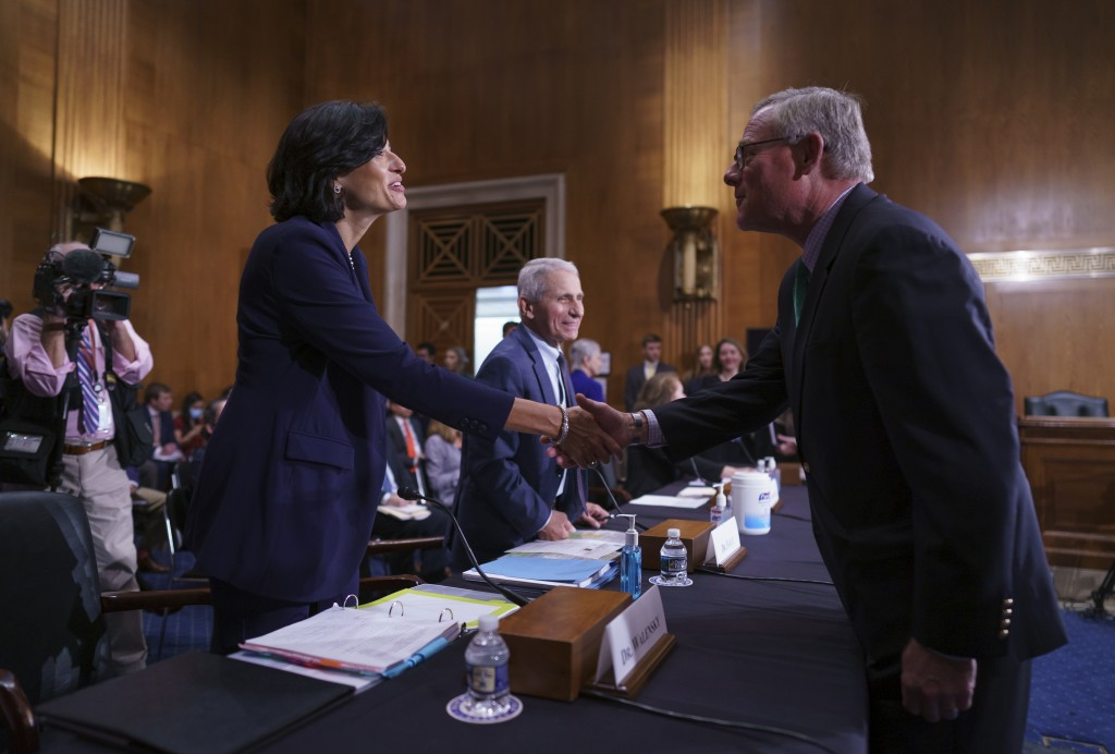 Dr. Rochelle Walensky, left, director of the Centers for Disease Control and Prevention, and top infectious disease expert Dr. Anthony Fauci, center, ...