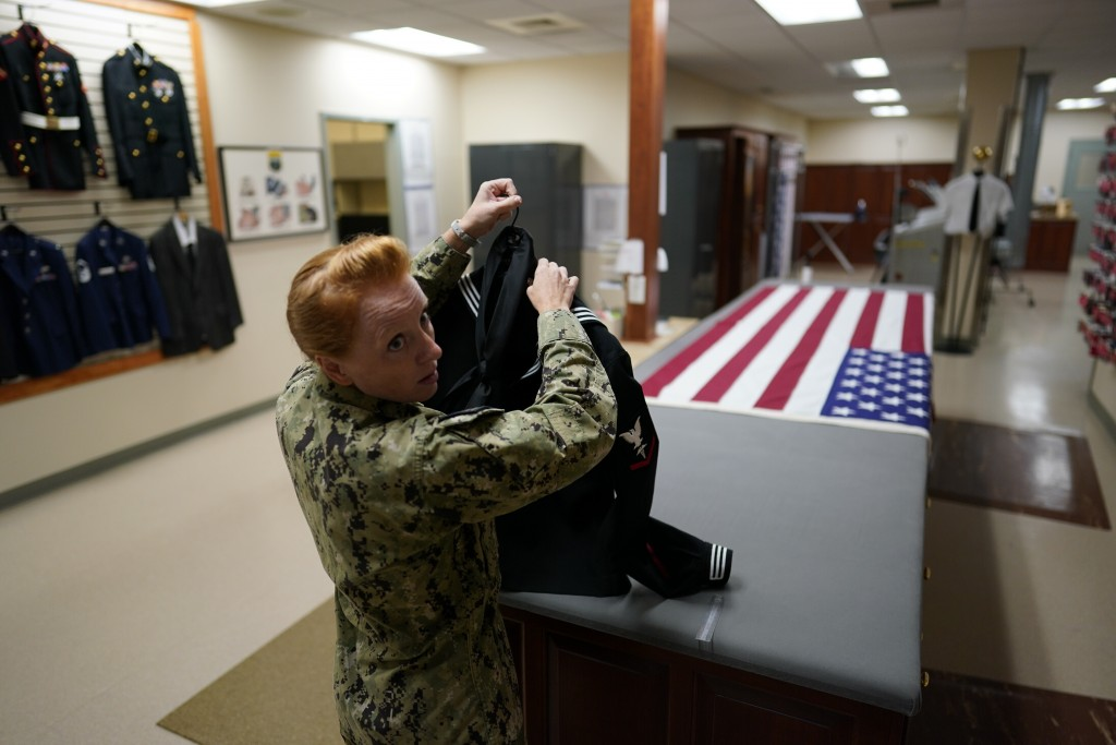 Chief Hospital Corpsman, United States Fleet Marine Forces, Jessica Zugzda prepares a dress Navy uniform in the uniform shop of the Air Force Mortuary...