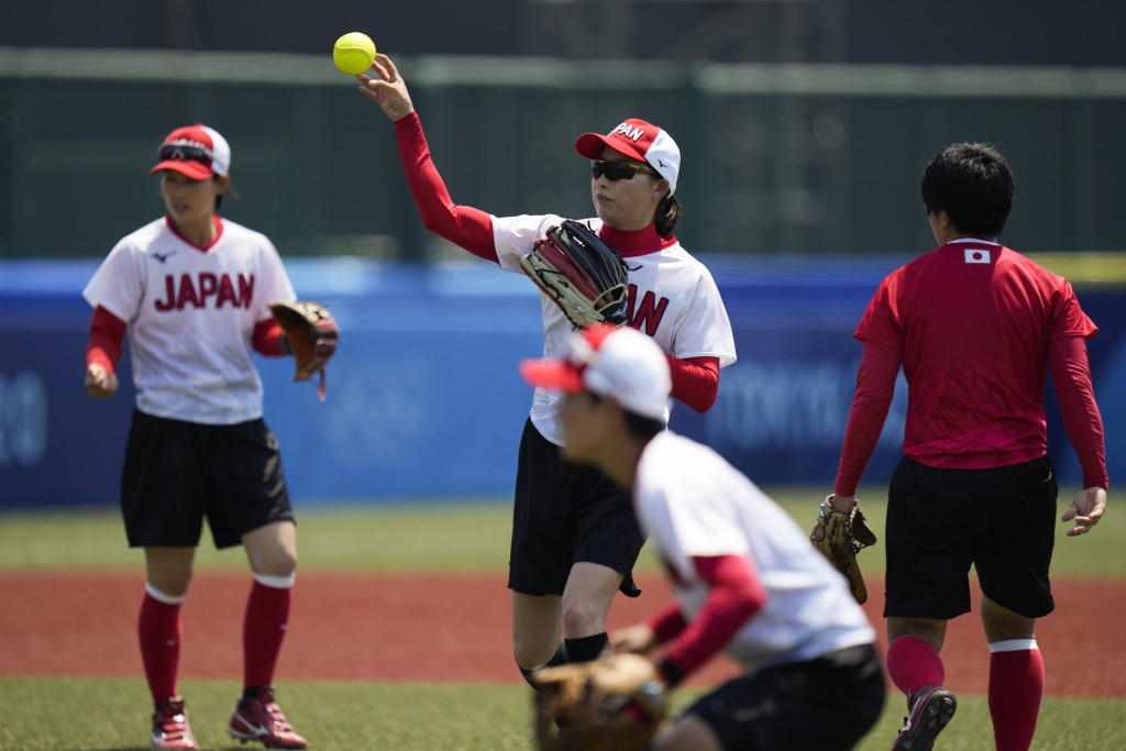 Members of the Japanese women's softball team train at the Fukushima Azuma Baseball Stadium ahead of the 2020 Summer Olympics, Tuesday, July 20, 2021,...