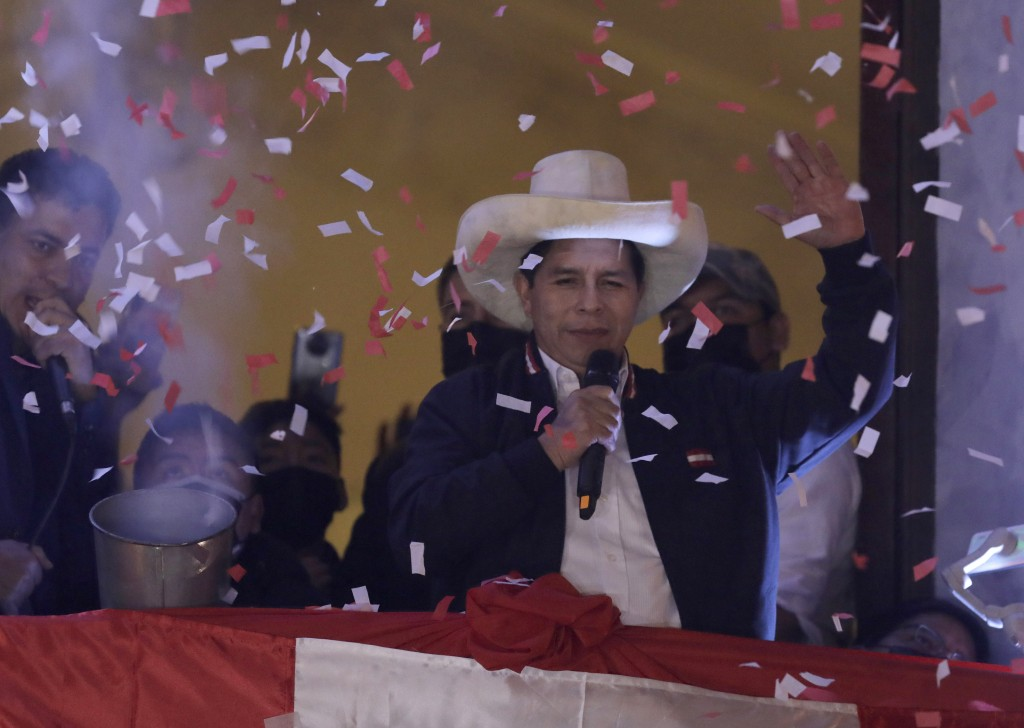 Pedro Castillo waves to supporters after election authorities declared him president-elect during celebrations at his party's campaign headquarters in...