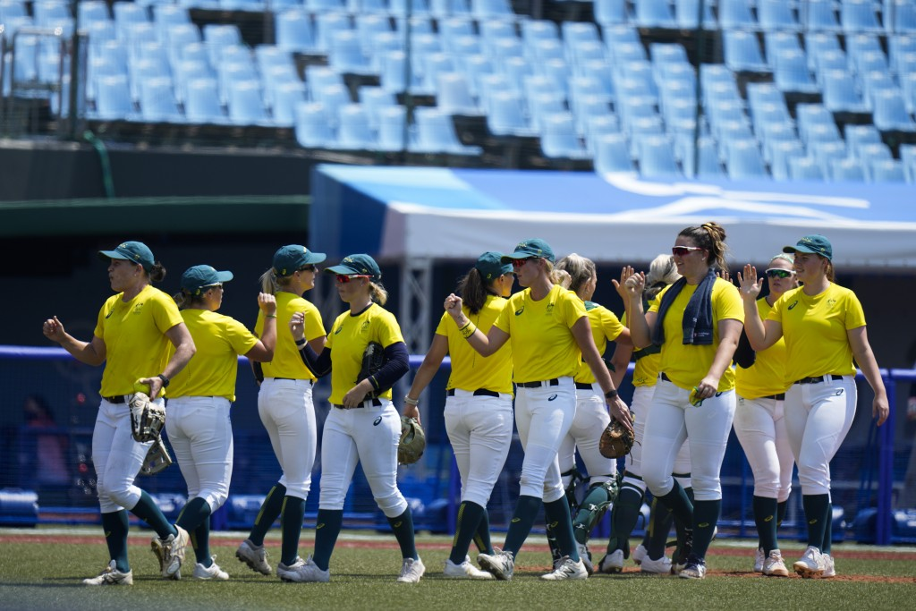 Australian softball players high-five after the team's training session at the Azuma Baseball Stadium ahead of the 2020 Summer Olympics, Tuesday, July...
