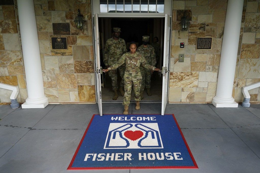 Tech Sgt. Ashley Harrell, joined by Senior Airman Myguerson Sainvilus, left, and Senior Airman lyana Green right, opens the doors of Dover Fisher Hous...