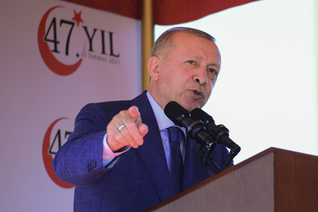 Turkish President Recep Tayyip Erdogan, talks before the military parade marking the 47th anniversary of the 1974 Turkish invasion in the Turkish occu...