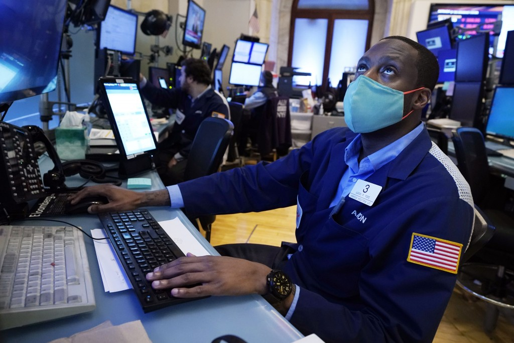Trader Aaron Ford works on the floor of the New York Stock Exchange, Monday, July 19, 2021. Resurgent pandemic worries knocked stocks lower from Wall ...