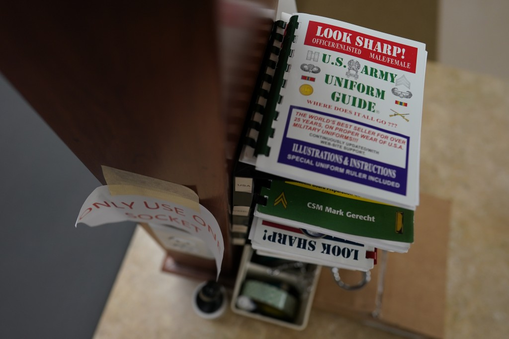 Military uniform guides are stacked in the uniform shop of the Air Force Mortuary Affairs Operations center at Dover Air Force Base, Del., Monday, Jun...