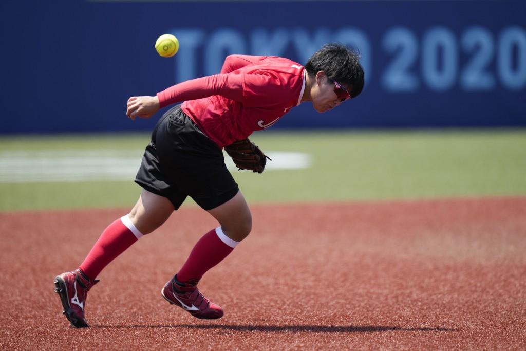 Japanese softball player Kawabata Hitomi misses the ball during the team's training session at the Fukushima Azuma Baseball Stadium ahead of the 2020 ...