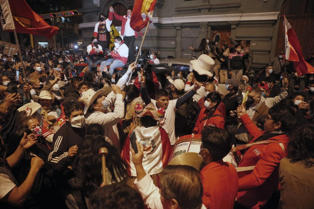 Supporters of Pedro Castillo celebrate after he was declared president-elect of Peru by the election authorities, in Lima Peru, Monday, July 19, 2021....