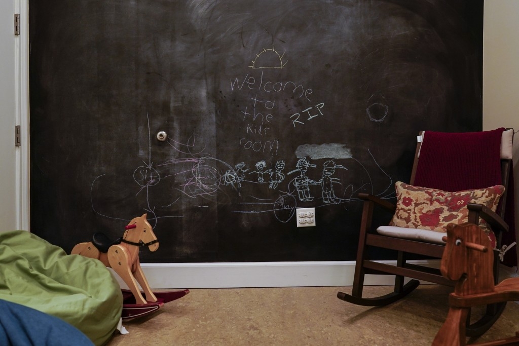 """A child's chalk drawing reads """"Welcome to the kid's room RIP"""" at Dover Fisher House at Dover Air Force Base, Del., Monday, June 21, 2021. Dover Fisher..."""