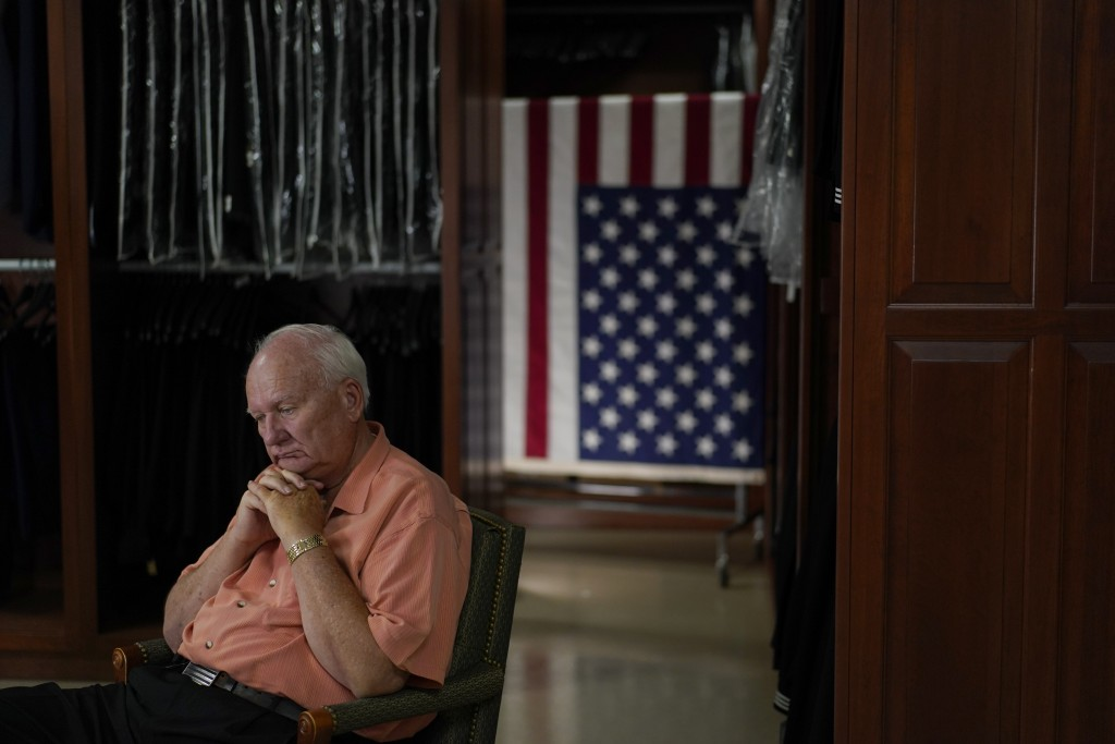 Air Force Mortuary Affairs Operations Senior Chaplain David Sparks pauses during an interview in the uniform shop of the Air Force Mortuary Affairs Op...