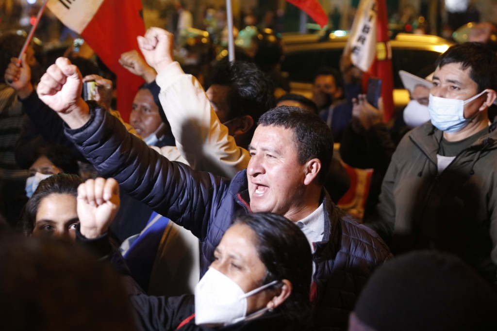 Supporters of Pedro Castillo celebrate after he was declared president-elect of Peru by the election authorities in Lima Peru, Monday, July 19, 2021. ...
