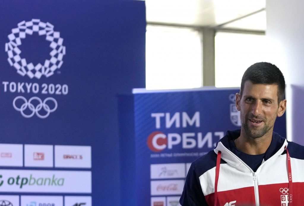 Serbia's tennis player Novak Djokovic leaves after a news conference at the Belgrade Airport, Serbia, before depart for The Tokyo Olympic Summer Games...