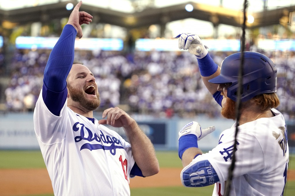 Los Angeles Dodgers' Justin Turner, right, celebrates his solo home run with Max Muncy during the first inning of a baseball game against the San Fran...