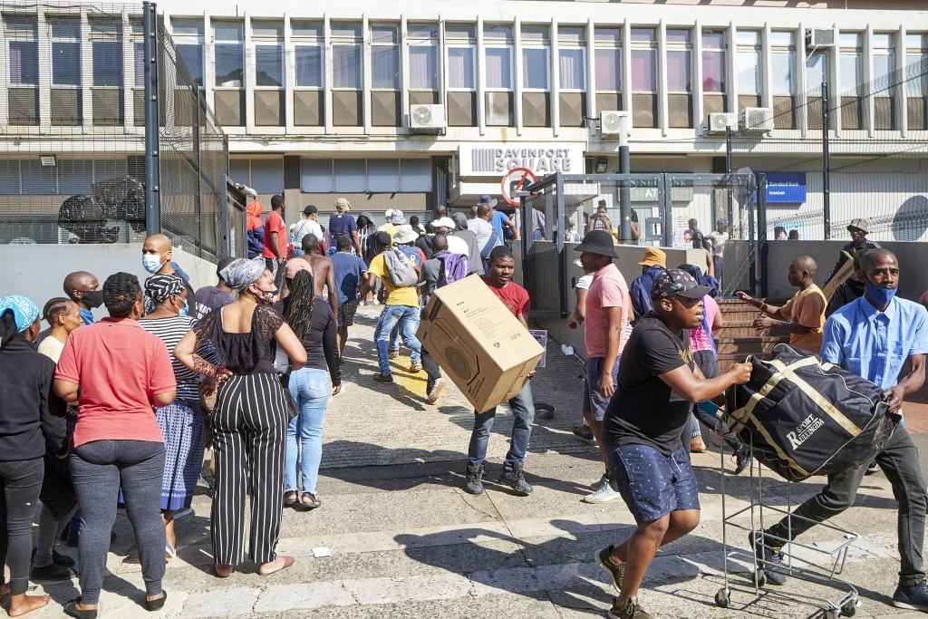 FILE - Looters make off with goods at a store in Durban, South Africa, Monday July 12, 2021. Former president Jacob Zuma's incarceration for contempt ...