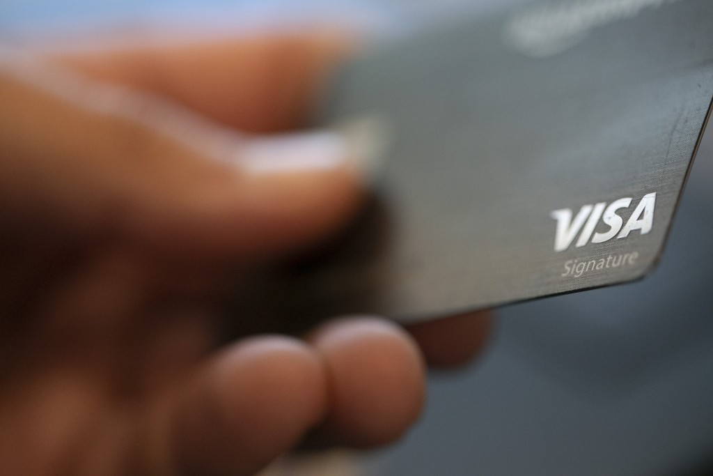 Consumer holds outVisa credit card.