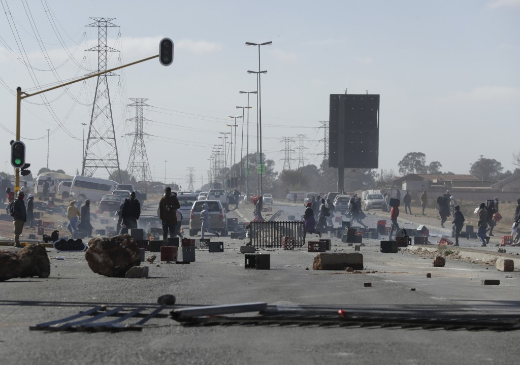 FILE - In this Tuesday, July 13, file photo, a road is barricaded in Soweto near Johannesburg, as ongoing looting and violence continued. Former presi...
