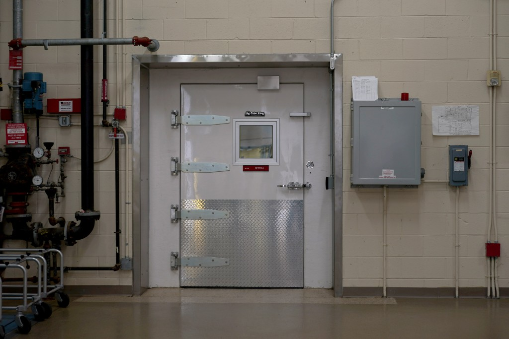 A walk-in cooler stands near the loading dock at Armed Forces Medical Examiner System (AFMES) facility at Dover Air Force Base, Del., Monday, June 21,...