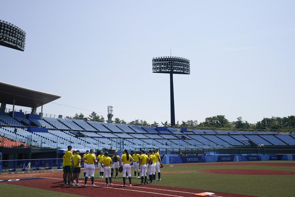 Members of the Australian softball team gather on the field during a training session at the Fukushima Azuma Baseball Stadium ahead of the 2020 Summer...