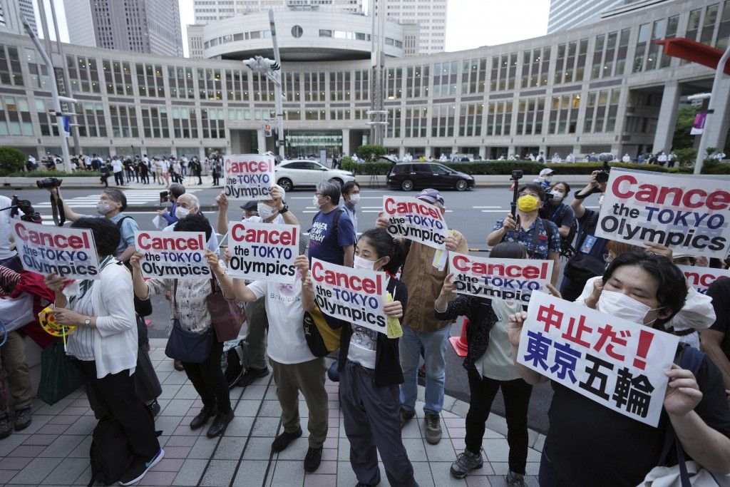 FILE - In this June 23, 2021, file photo, people protest against the July opening of the Tokyo 2020 Olympics near the Tokyo Metropolitan Government bu...