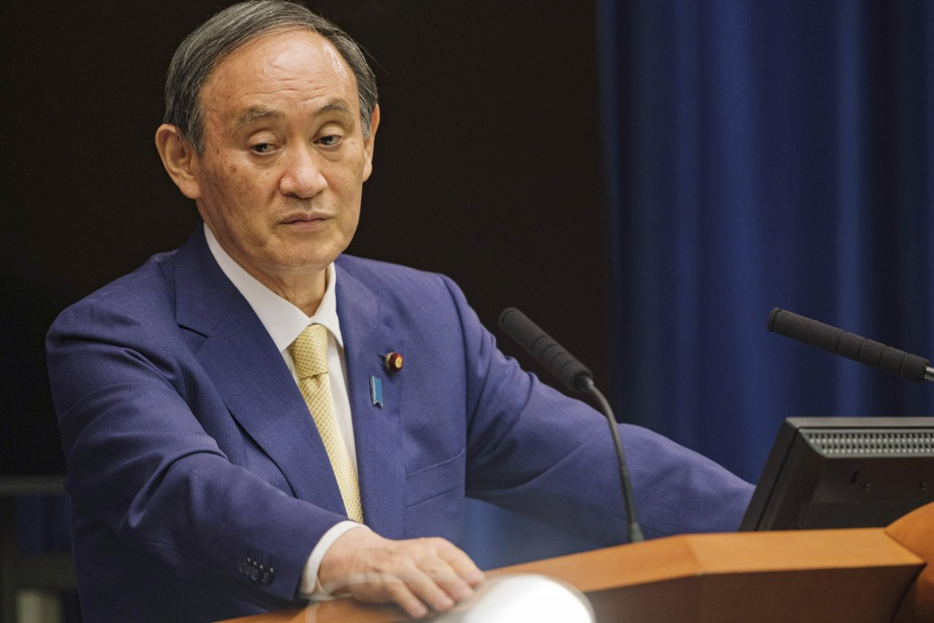 FILE - In this July 8, 2021, file photo, Japan's Prime Minister Yoshihide Suga speaks during a news conference at his official residence in Tokyo. The...