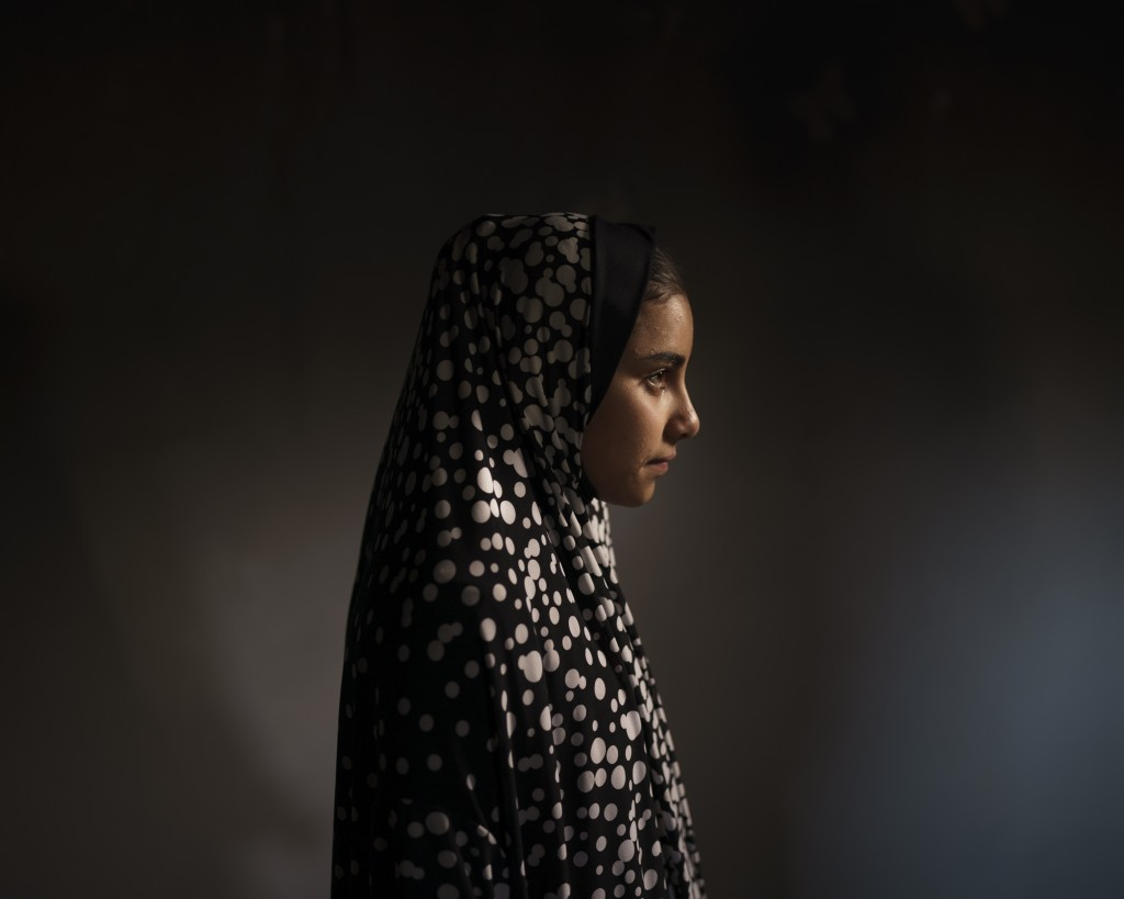 Batool al-Masri, 14, poses for a portrait at her house in Beit Hanoun, northern Gaza Strip, Sunday, June 20, 2021. In a field near their home on May 1...