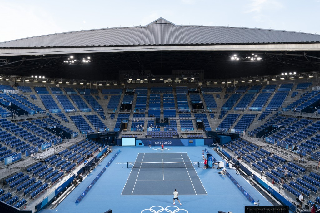 Novak Djokovic, of Serbia, in the far court, practices at the Ariake Tennis Center ahead of the 2020 Summer Olympics, Wednesday, July 21, 2021, in Tok...