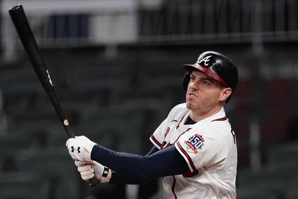 Atlanta Braves first baseman Freddie Freeman (5) hits a solo home run in the sixth inning of a baseball game against the San Diego Padres Tuesday, Jul...