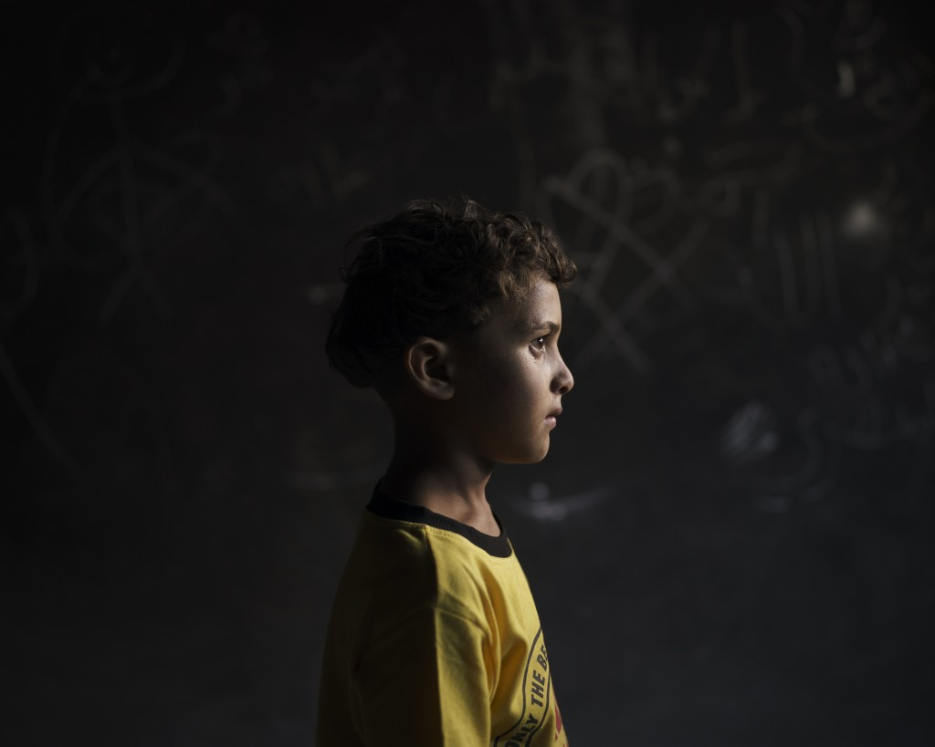 Qasim al-Masri, 6, poses for a portrait at his house in Beit Hanoun, northern Gaza Strip, on Sunday, June 20, 2021. A May 10 explosion in a field near...