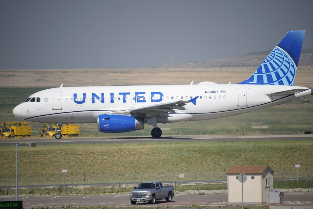 FILE - A United Airlines jetliner taxis down a runway for take off from Denver International Airport Friday, July 2, 2021, in Denver. United Airlines ...