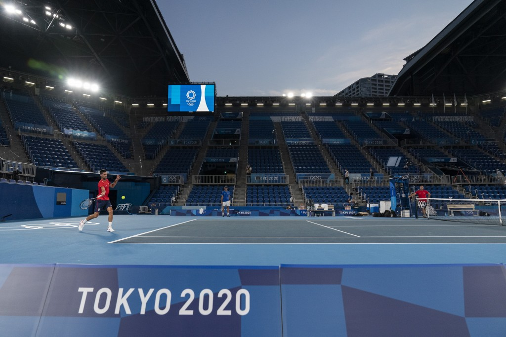 Novak Djokovic, of Serbia, left, practices at the Ariake Tennis Center ahead of the 2020 Summer Olympics, Wednesday, July 21, 2021, in Tokyo, Japan. (...