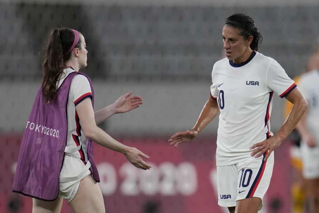 United States' Carli Lloyd, right, leaves the field after losing 0-3 against Sweden during a women's soccer match against Sweden at the 2020 Summer Ol...