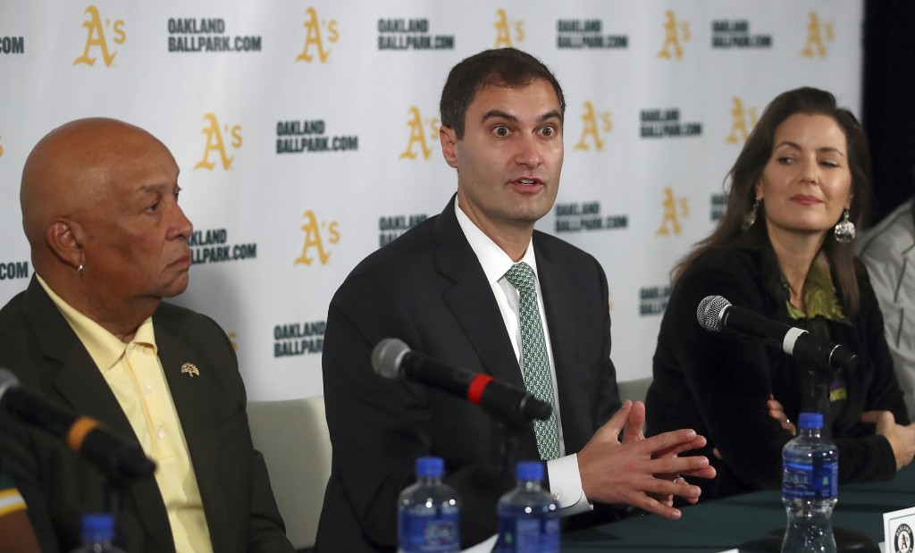 FILE - In this Nov. 28, 2018, file photo Oakland Athletics President Dave Kaval, center, speaks beside Oakland Mayor Libby Schaaf, right, and Ces Butn...