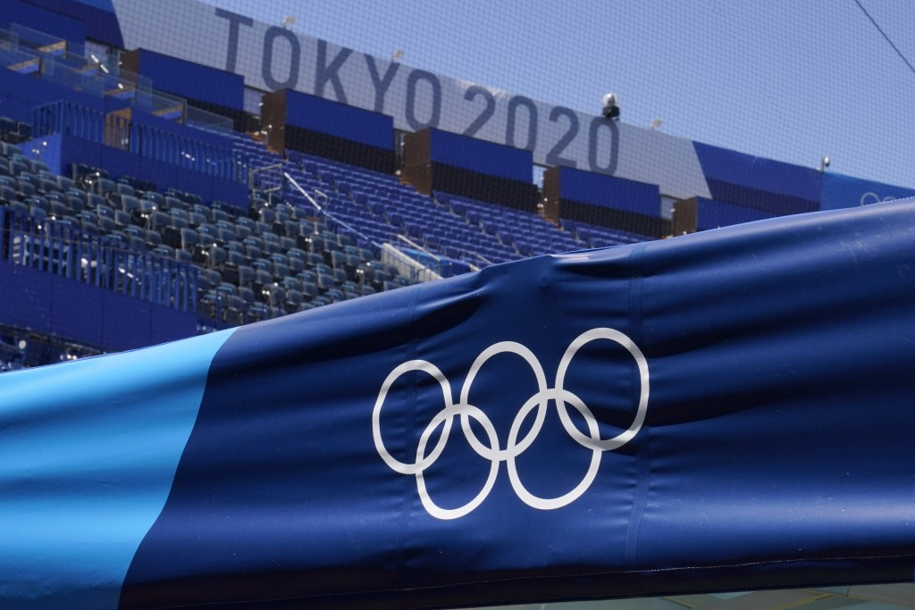 The Olympic Rings and a Tokyo 2020 sign are pictured inside Yokohama Baseball Stadium at the 2020 Summer Olympics, Wednesday, July 21, 2021, in Yokoha...