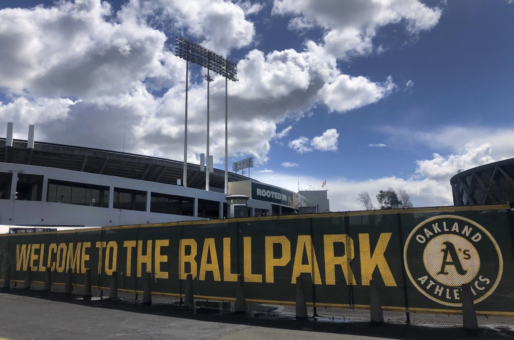 FILE — In this March 25, 2020, file photo a banner has a welcome message to Oakland Athletics fans at the Oakland-Alameda County Coliseum in Oakland, ...