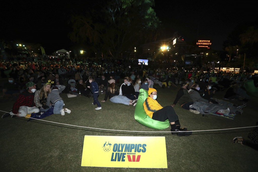 People gather Wednesday, July 21 , 2021, in Brisbane, Australia, for the announcement by the International Olympic Committee (IOC) on 2032 Summer Olym...