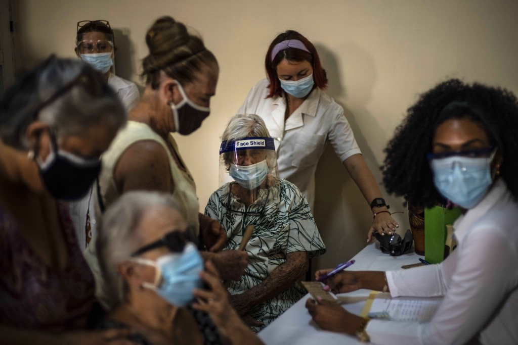 FILE - In this June 23, 2021 file photo, people sign up for a dose of the Cuban Abdala COVID-19 vaccine in Havana, Cuba. Cuba has been trying to rapid...