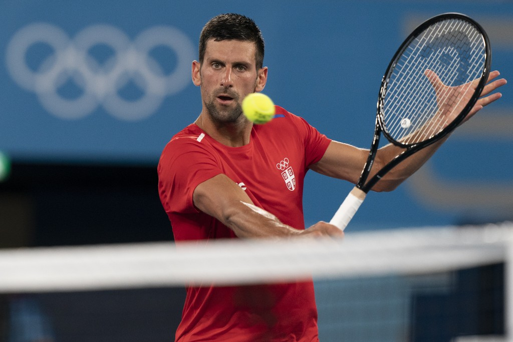 Novak Djokovic, of Serbia, practices at the Ariake Tennis Center ahead of the 2020 Summer Olympics, Wednesday, July 21, 2021, in Tokyo, Japan. (AP Pho...