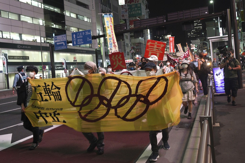 FILE - In this June 23, 2021, file photo, protesters call for the cancellation of the Tokyo Olympics slated to start in 30 days, near the Tokyo Metrop...