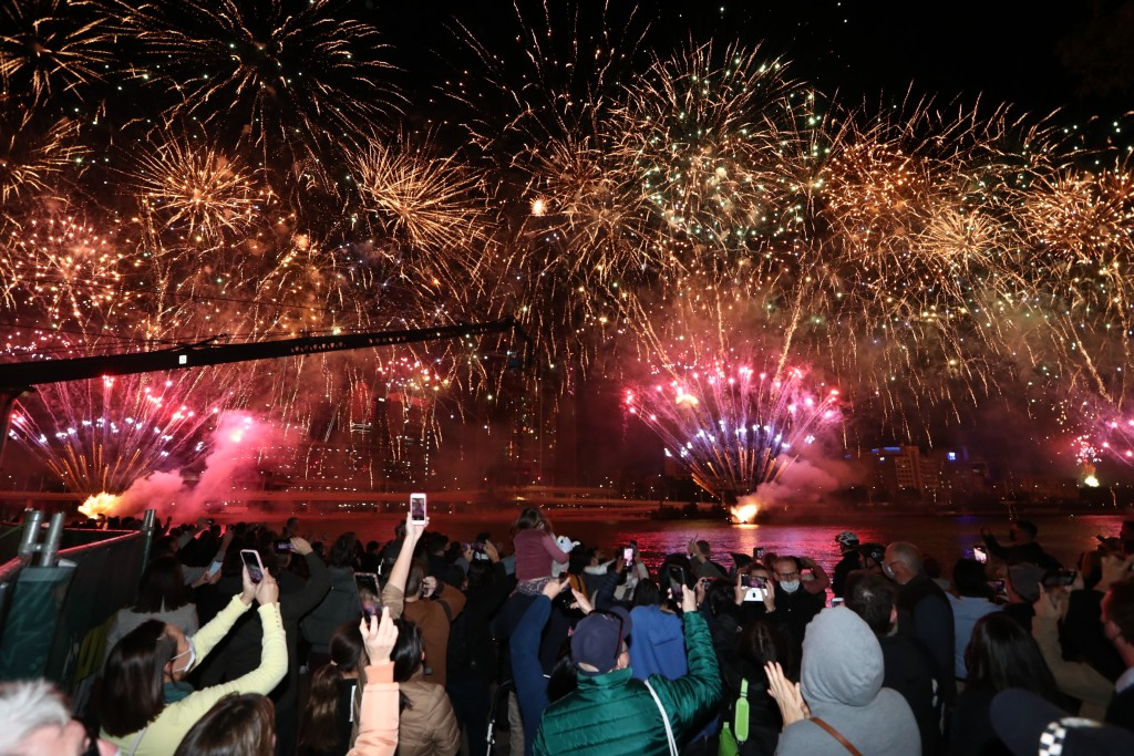 People celebrate in Brisbane, Australia, Wednesday, July 21, 2021, following an announcement by the International Olympic Committee that Brisbane was ...