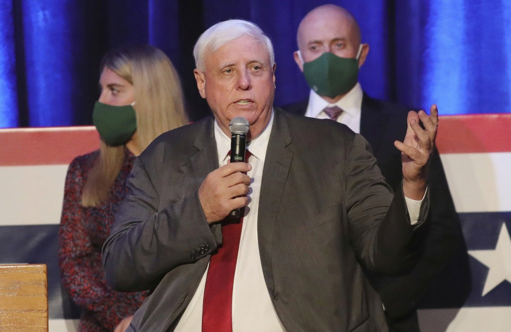 FILE - In this Nov. 3, 2020, file photo, West Virginia Gov. Jim Justice celebrates his reelection at The Greenbrier Resort in White Sulphur Springs, W...