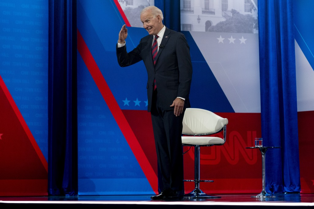 President Joe Biden interacts with members of the audience during a commercial break for a CNN town hall at Mount St. Joseph University in Cincinnati,...