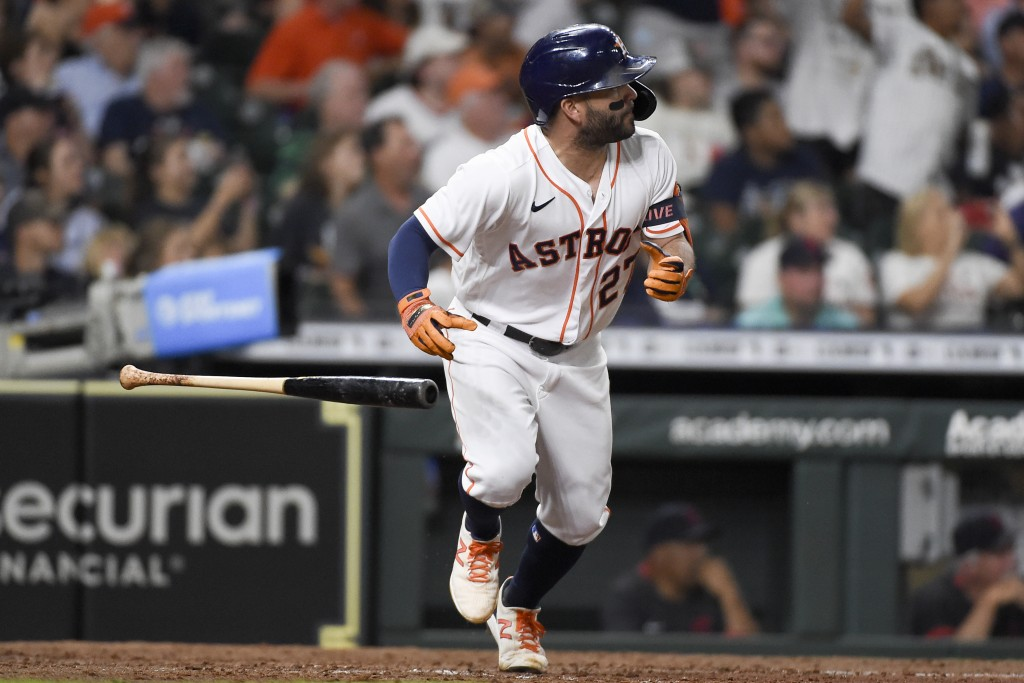 Houston Astros' Jose Altuve watches his RBI double during the sixth inning of the team's baseball game against the Cleveland Indians, Wednesday, July ...