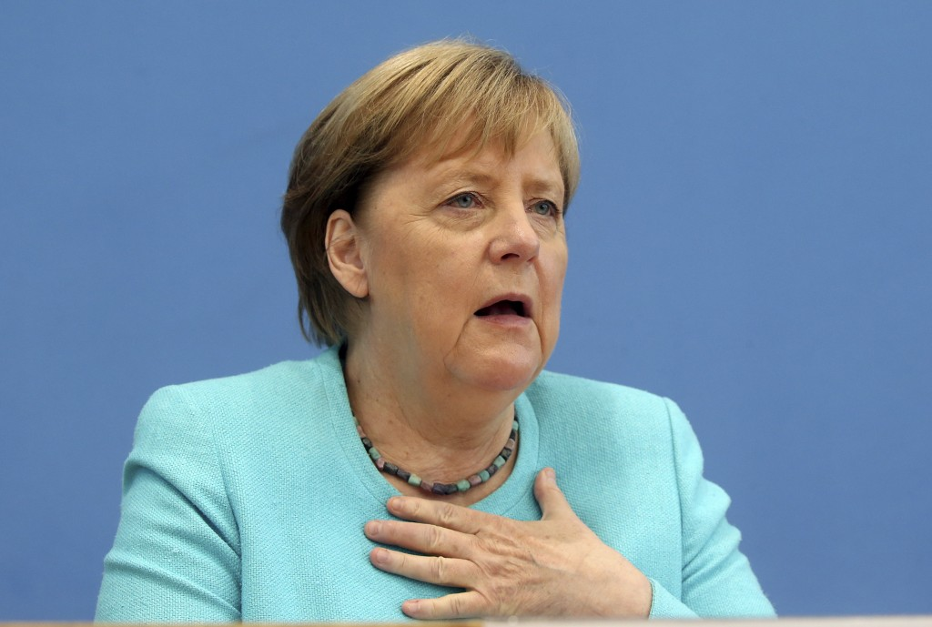 German Chancellor Angela Merkel, gestures, as she holds her annual summer news conference in Berlin, Germany, Thursday, July 22, 2021.  Merkel said Th...