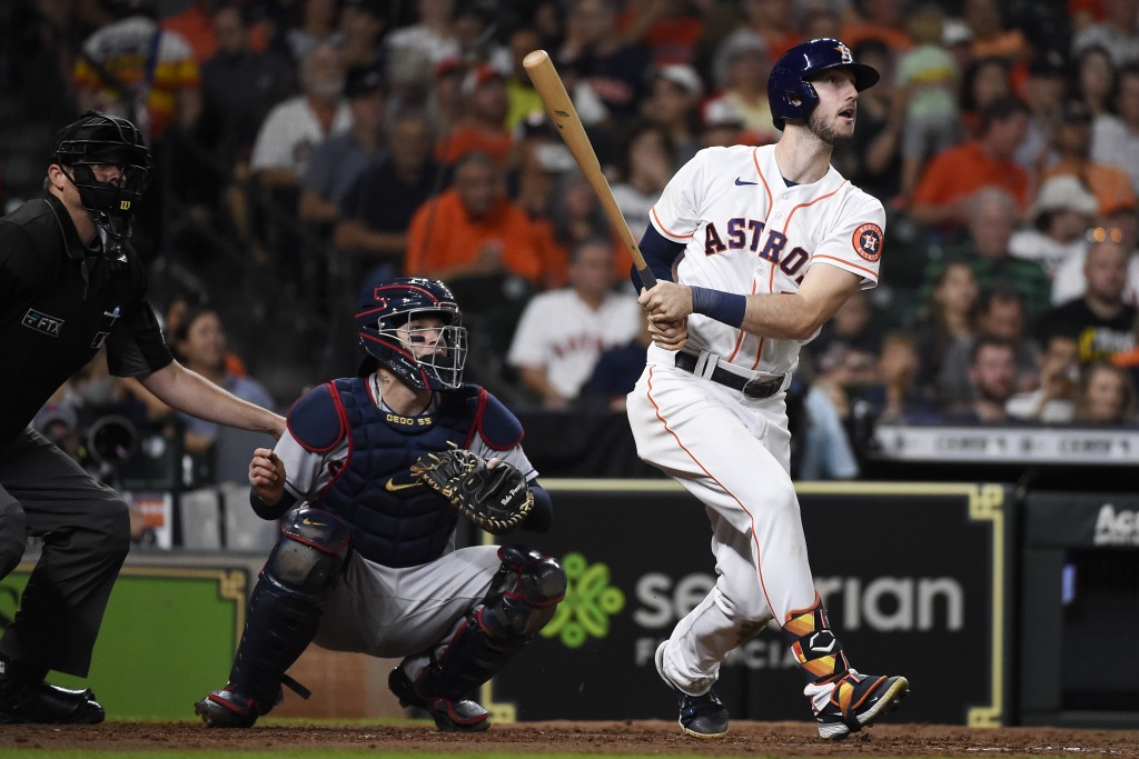 Houston Astros' Kyle Tucker, right, watches his solo home run during the fifth inning of the team's baseball game against the Cleveland Indians, Wedne...